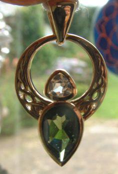 Moldavite and Danburite pendant set in 14ct gold