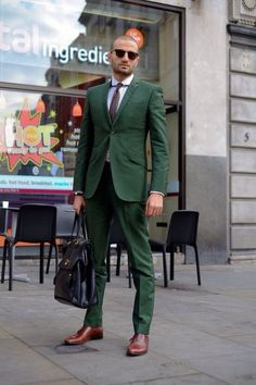 Shop this look on Lookastic:  http://lookastic.com/men/looks/tie-and-dress-shirt-and-suit-and-briefcase-and-oxford-shoes/3846  — Dark Brown Tie  — White Dress Shirt  — Dark Green Suit  — Black Leather Briefcase  — Dark Brown Leather Oxford Shoes
