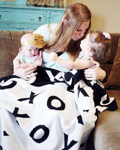 A sweet mama and daughter moment with Modern Burlap's XO reversible blanket throw. LOVE how cuddly this blanket is - perfect for the entire family. #modernburlap