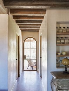 mix modern and farmhouse hallway idea curved top window exposed ceiling beams tiles floors House Design, House, Home, French Farmhouse, Eclectic Farmhouse, Stucco Homes, Rustic Remodel, Farmhouse Style House, Rustic Interiors