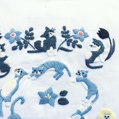 Japanese embroidery of cats