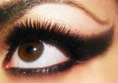 Those lashes and that giant eye liner corner? The only way to make that better is to add glitter - oh wait, they did!