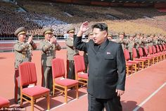 Kim Jong-un laps up the applause ahead of a military parade to celebrate the state's 70th annivesary