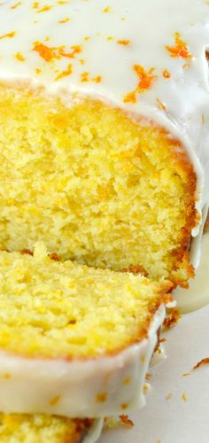 Orange Pound Cake with Orange Syrup and Orange Glaze. This cake is loaded with amazing Orange flavor! Tender and Moist! The Orange Syrup puts this cake in a class of it's own!!! A wonderful Cake from Ina Garten :)
