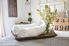 A wooden tray with fresh towels and flowers.. 10 Ways To Prepare Your Home For Overnight Guests -