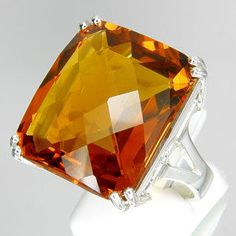 Madeira Citrine Ring.  27.20 carats!!  $385, it's so pretty and BIG!  This site has so many beautiful HUGE gemstone rings and other jewelry!!  EPB