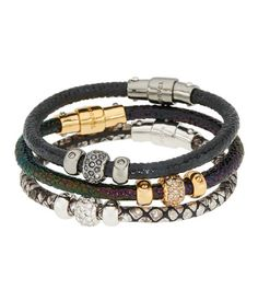 <p>The Triple Leather bracelet is what we like to call boho bling. Crafted with a complementary trio of leathers and adorned with shimmering crystals, this designer bracelet is for the Bendel Girl whose style can never be categorized nor contained.</p>