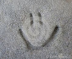 A smiley face carved into stone.