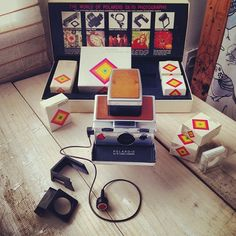 Polaroid SX-70 and accessory kit box.