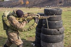 An East Ukrainian fast response team member training with his PKM and Ironman backpack.