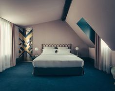 Light purple and pink Art Deco styled room with rich green carpet - Art Deco inspired designs of the Hotel Saint Marc luxury boutique hotel in central Paris, France. Retro Interior Design inspiration and images from the hotel featured on the Martyn White Designs Blog
