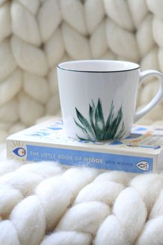 Beautiful chunky knit throws, mugs, and The Little Book of Hygge. Bathroom Accessories, Home Accessories, Hygge Book, Design Your Bedroom, Chunky Knit Throw, Knitted Throws, Little Books, Amazing Bathrooms, Small Bathroom