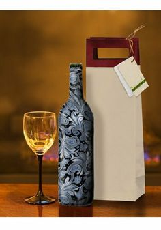 KimCo Products - Wine Bottle Covers - Pewter Paisley by KimCo Products LLC. $3.99. Quality Stretchable Fabric. Fits 750ML Bottles. Fashionalble and Stylish Designs. Reusable and Washable. Perfect for any Occasion. The new way to wrap wine! Simply slip wine bottle cover over the neck of the bottle.  Pull down wine bottle cover to the base of the bottle.  Perfect for any occasion!   Be responsible. Don't Drink and Drive.