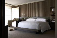 Park Hyatt, Sydney.  Headboard incorporating nightstand and full height mirror.