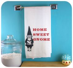 This adorable kitchen towel features a large gnome and the phrase 'Home sweet gnome' eco friendly gifts perfect for housewarming or your favorite hostess.