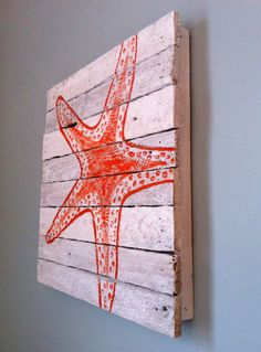 Orange painted starfish - reclaimed wood