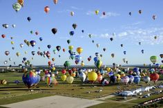 Hundreds of hot air balloons reach for records in France. How much heated air's in there? What's the volume of hot air in the number of balloons that launched?