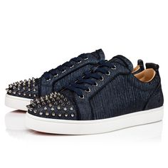 The Louis Junior Spikes Orlato low sneaker is an iconic Maison Christian Louboutin shoe and revisits the graphic codes of the tennis world. Set on a white rubber sole, its elegant upper is accentuated at the front by signature metallic spikes. It comes dressed in a gala fabric, a clever combination of blue and black, and highlighted by grosgrain borders around the heel cap and the facing. Tennis World, Red Sole, Christian Louboutin Shoes, Spikes, Grosgrain, Online Boutiques, Casual Shoes, Men's Shoes, High Top Sneakers