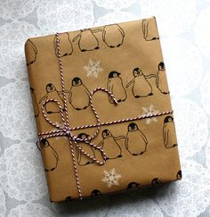 Penguin gift wrap Snowflakes wrapping paper by ThePrintBee