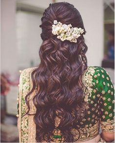 Beautiful half undo hairstyle with curls | The ultimate guide for the Indian Bride to plan her dream wedding. Witty Vows shares things no one tells brides, covers real weddings, ideas, inspirations, design trends and the right vendors, candid photographers etc.| #bridsmaids #inspiration #IndianWedding | Curated by #WittyVows - Things no one tells Brides | www.wittyvows.com