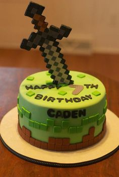 This amazing Minecraft cake is topped with a pixelated sword.