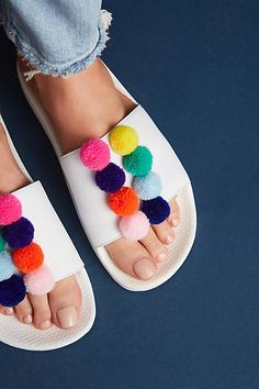 South Parade Pom Pom Pool Slides. They're so funky and fun. Pom-poms are one of the biggest trends this spring/summer. Head over to Anthropologie here at The Promenade today. Plus check out their sale section where they're offering an additional 30% off.