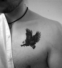 Small Simple Mens Eagle Black Ink Upper Chest Tattoo