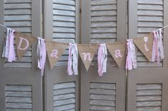 """Personalized bunting banner with brown burlap and pink letters forming the Greek name """"Danai"""" - Parenting Greek Names, Personalised Bunting, Burlap Flag, Butterfly Birthday, Letter Form, Name Banners, Bunting Banner, Fabric Ribbon, 1st Birthday Girls"""