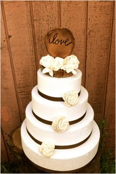 Cute and Chic Rustic Wedding Cake Toppers...maybe with peach flowers, babies breath and burlap/twine instead of ribbon?