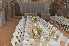 Rustic wedding reception floral table arrangements