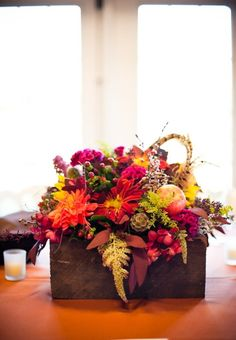 Fall flowers, wooden boxes from garage to mix in with centerpieces