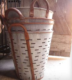Vintage galvanized metal bucket was used to carry olives back from the harvest. But now, the olive basket is available in all of its aged-patina glory, for your home decorating pleasure. Even if you don't grow olives.