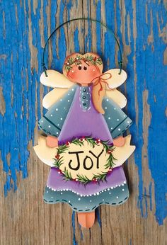 Whimsical Holiday Joy Angel ornament. Hand cut from 1/8 Baltic Birch wood. Design by Renee Mullins. Hand painted by me. Beautiful ornament to add to your tree or give as a gift.  Measures approximately 5 x 3.