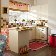 Cream country kitchen with red accessories | Kitchen decorating | Style at Home | Housetohome.co.uk