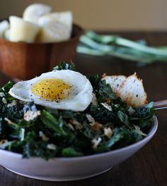 Tender kale massaged in a mustard-lemon vinaigrette is a tasty way to enjoy this famous superfood. Kale salad becomes a main entree through The Roasted Root's recipe which tops the massage kale sal...