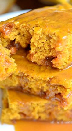 Pumpkin Caramel Blondies ~ The gooey caramel bits that get baked inside and the caramel topping turns these blonde cakes into gooey deliciousness!