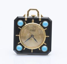 Van Cleef Arpels AND 1935  square neck watch 14K yellow gold (585 thousandths) and onyx decorated with four turquoise cabochons, signed the golden dial, hands sword blued steel, crown at 12 o'clock. Background leaving the skeleton appear mechanical movement with manual winding.