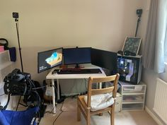 My battlestation: mismatched triples on cheap stand complete lack of cable management kitchen table chair