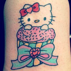 Hello Kitty cupcake tattoo with gem heart - what's not to like?
