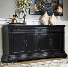 """Create a classically stunning entertainment setup in your living room or den with this new Bronson 68.5"""" media credenza. Its black rub finish, antiqued brass hardware and reeded pilasters provide charming traditional style. Plus, wire management cutouts make it easy to keep cords organized."""