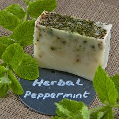 Herbal Peppermint Soap. A true wake up call awaits you as you reach for this invigorating, energising and refreshing bar.  Peppermint acts as a mild, natural stimulant to increase vitality and clarity – a great way to start the day. Herbal peppermint is flecked with dried mint and herbs.