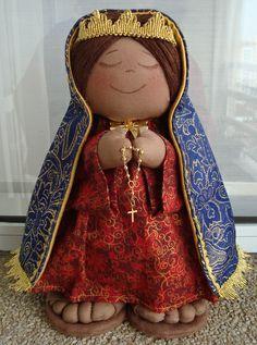 Nossa Senhora Aparecida .25cm x 12cm x 7 cm aproximado 230g aproximado. Tecido algodão 100%, brocado, forro dourado e aviamentos dourados.