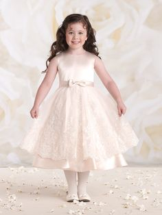 First Communion dresses in the Joan Calabrese Collection by Mon Cheri are available in ball gown, fit and flare, or A-line dress styles. Featuring traditional white dresses with sleeveless or short-sleeved options. Designer First Communion Dresses, Girls Designer Dresses, Holy Communion Dresses, Little Girl Dresses, Girls Dresses, Flower Girl Dresses, Flower Girls, Ball Gown Dresses, Tulle Dress