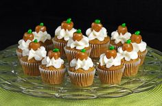 Caramel apple mini cupcakes with caramel apple toppers! Candy coated sunflower seed used as leaves :)