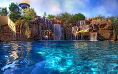 We will show you 20 amazing pools with waterfalls to inspire you for this fabulous water feature. If you have a swimming pool in the backyard you can create Luxury Swimming Pools, Luxury Pools, Dream Pools, Swimming Pools Backyard, Swimming Pool Designs, Pool Landscaping, Indoor Pools, Lap Pools, Pool Decks