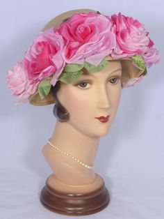 Who doesn't love roses? And, with this pretty 1950s straw hat, you will have lots of roses to love! The base of the hat is woven natural straw with