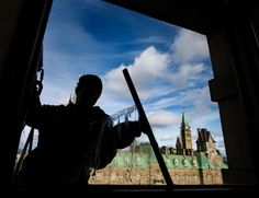 A window washer does his best to clean up the view of Parliament Hill in Ottawa.