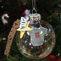 Die-cut the year and a phrase to celebrate the life moments from 2013. This baby's 1st Christmas ornament is just adorable!