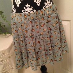 """Cute, Light green, short, sheer 3-tier skirt. This adorable light green, brown floral print is sheer with lining. 2"""" wide elastic waistband. Perfect for Spring/Summer! Cute paired with a brown belt. Skirts"""