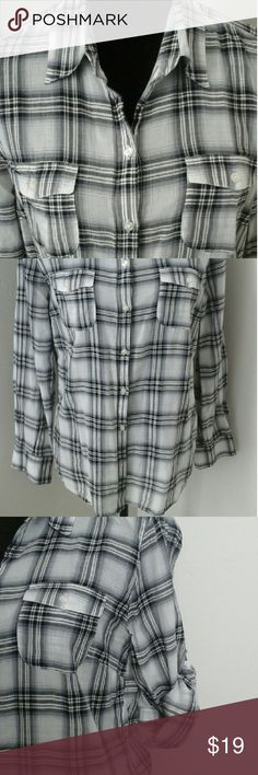 Trendy Plaid Shirt by Gap Lightweight 99 percent  cotton 1 percent  metallic because there are hints of silver in between the black and grey stripes. Great for layering. Comfortable, gently used, no rips stains or holes.  Great for fall too. Length  27 inches. Width is  20 inches.  Sleeves are 24 inches. Excellent condition. Fits 10/12. Plaid has grey white and black in it. Sleeves can be rolled up with button to hold in place. GAP Tops Button Down Shirts